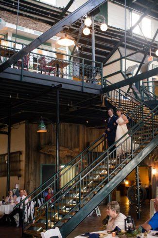 newlyweds walk down staircase Abe Jake's Landing