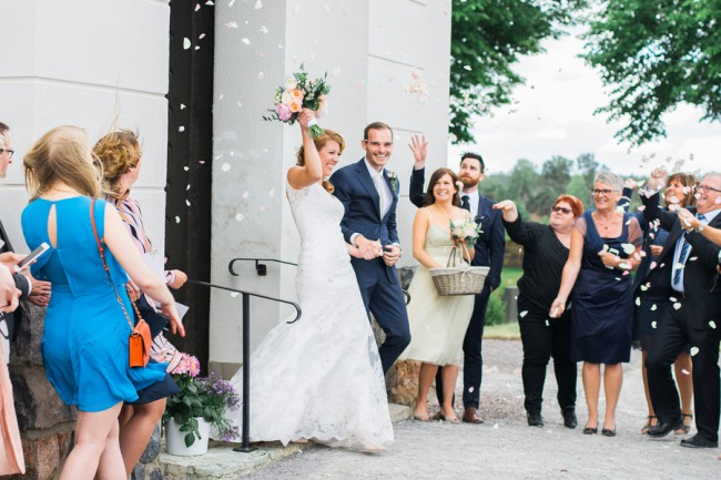 newlyweds walk out of church to petals being thrown