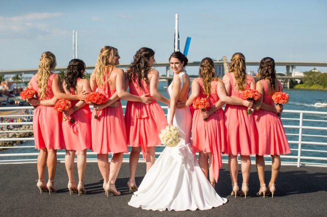 pink-bridesmaid-dresses-with-bride-in-middle