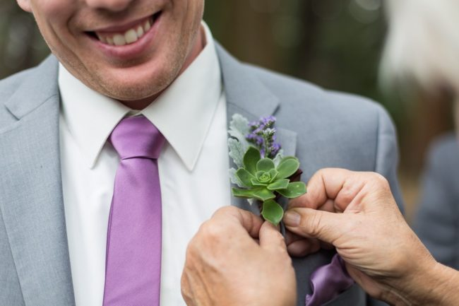 pinning on succulent boutonniere