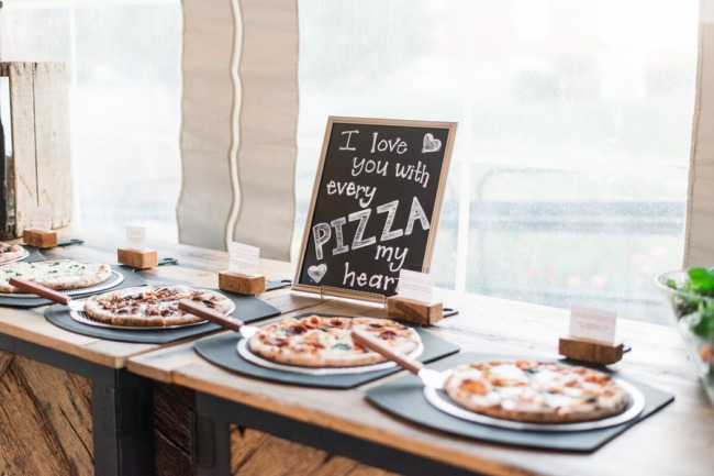 pizzas with chalkboard sign