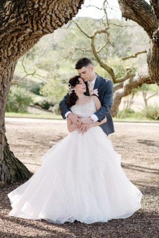 styled couple under tree