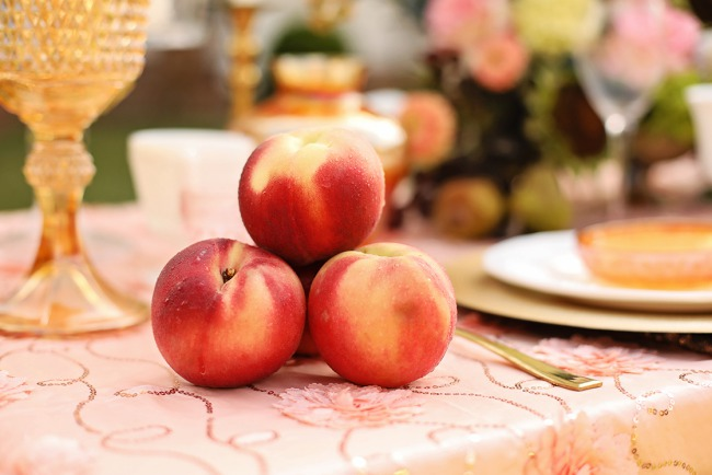 three peaches on table