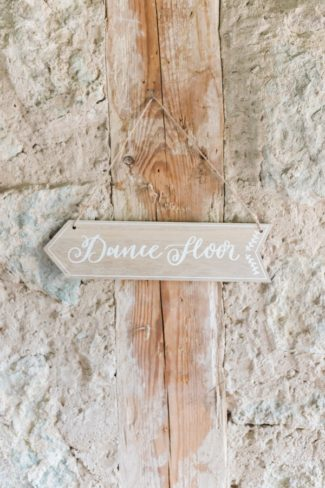 wood arrow sign to dance floor