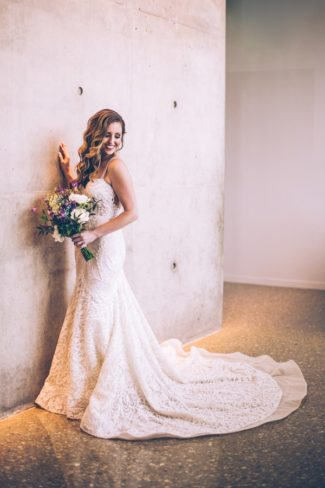 Bride in long gown at Perot Museum