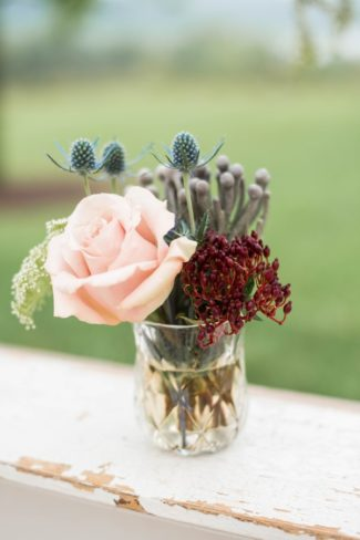 blue thistle and peach rose