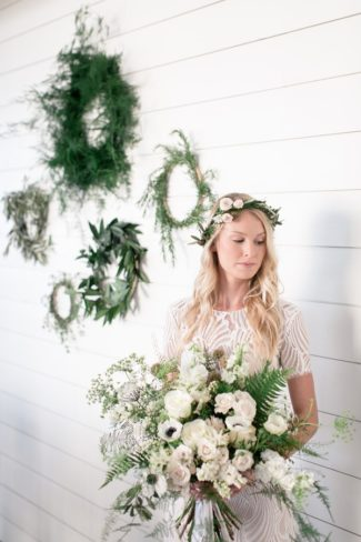 bridal bouquet with wreaths on wall