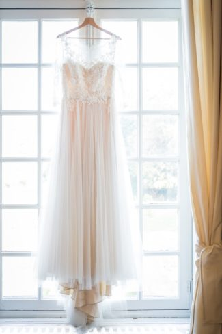 bridal dress hanging in window