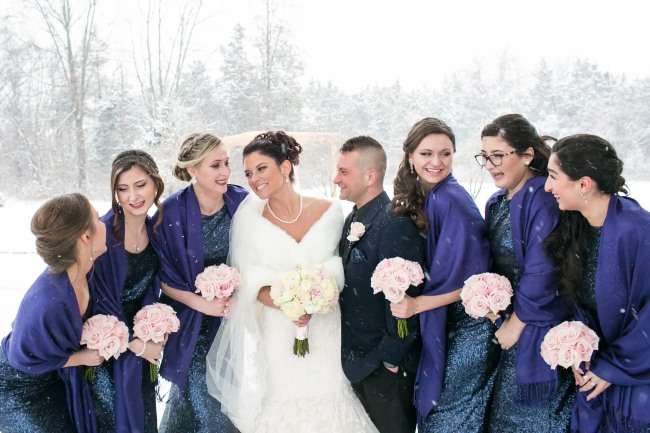 bridal party in snowy outdoors