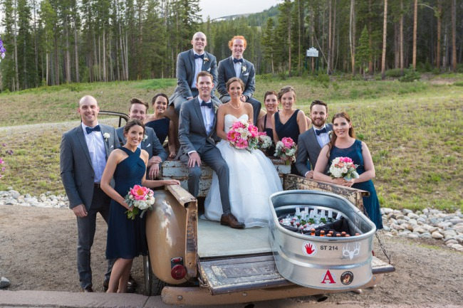bridal party on back of pickup truck