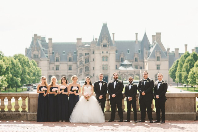 bridal party with Biltmore in background
