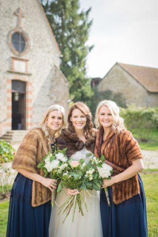 bridesmaids in shrugs with bride