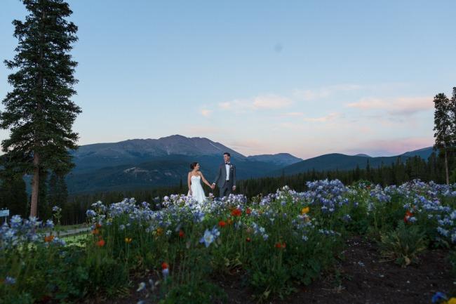 couple among wildflowers on Colorado mountain