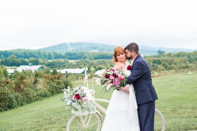 couple with vintage bike overlook valley