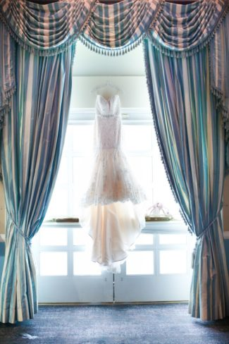 dress hanging in window of The Palace at Somerset Park