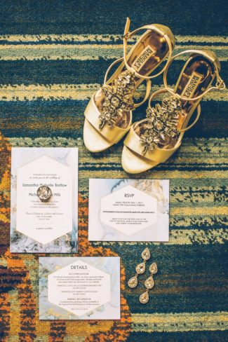gold Badgley Mischka shoes with stationery suite