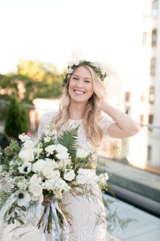 gorgeous woman with floral crown and bouquet