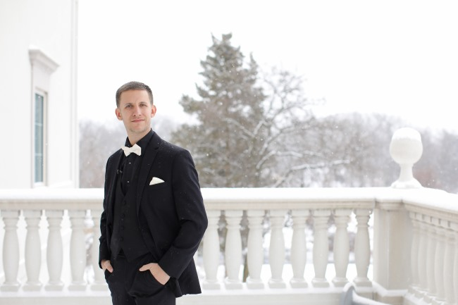 groom on snowy balcony of The Palace at Somerset Park