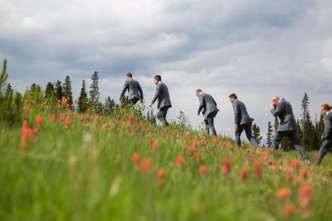 groomsmen hike up wildflower hill