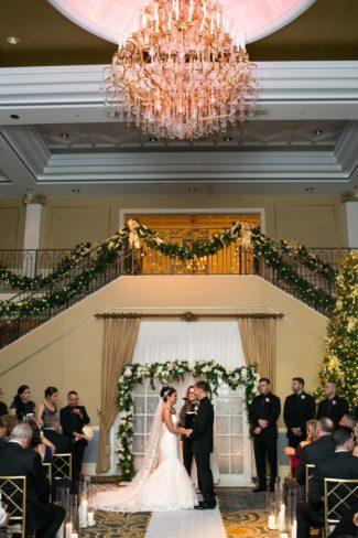 indoor ceremony under giant chandelier