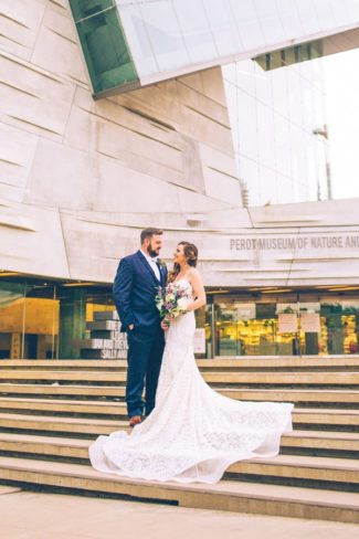newlywed portrait on steps of Museum