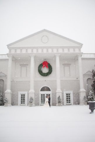 newlyweds in front of snowy Palace at Somerset Park