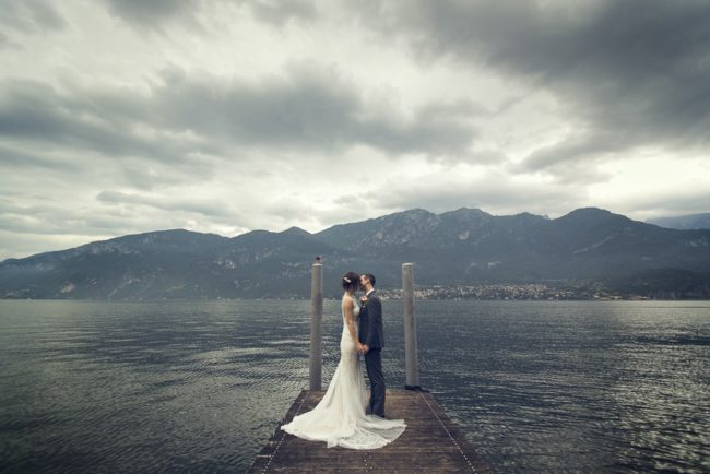 newlyweds on dock at Lake Como