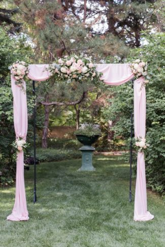 outdoor alter with pink sheers and flowers