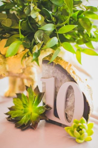 table number on stylish rock