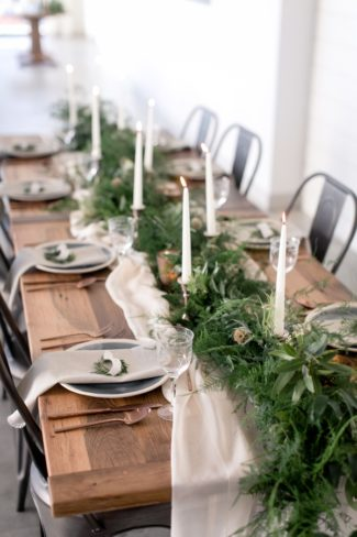 tablescape with greenery and candles