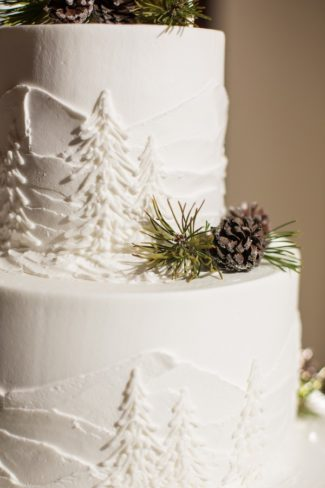 wedding cake with pine cones and fir tree