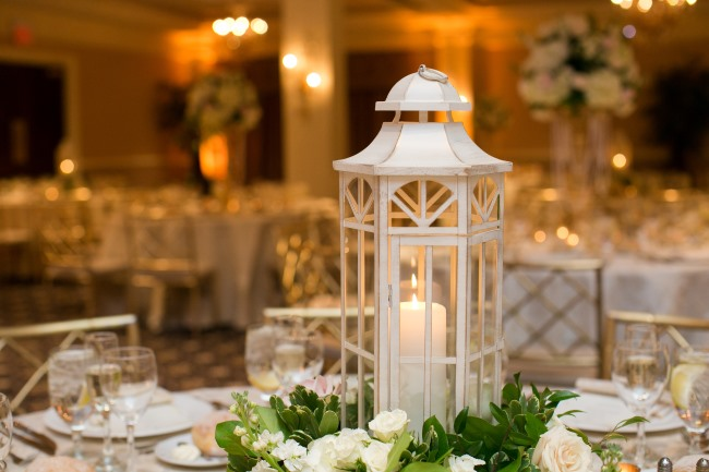 white lantern with candle centerpiece