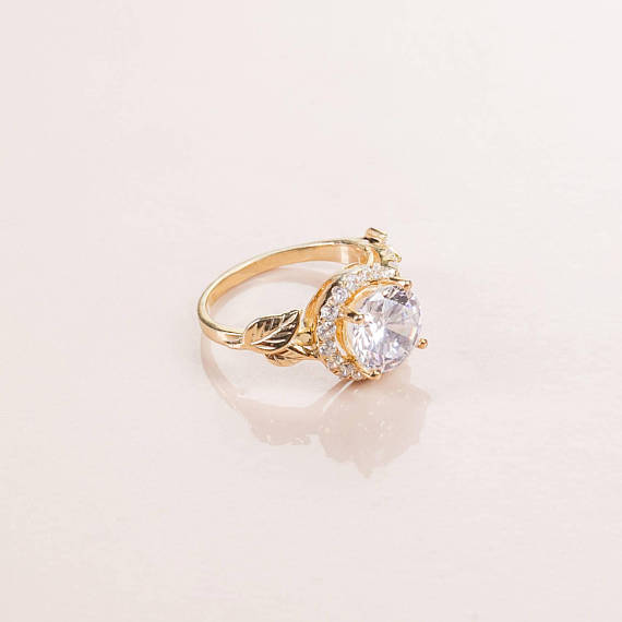 Diamond engagement ring with leaf detailing