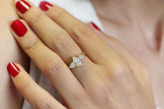 Pear Shaped Diamond with 2 Heart Shaped Side Diamonds Engagement Ring