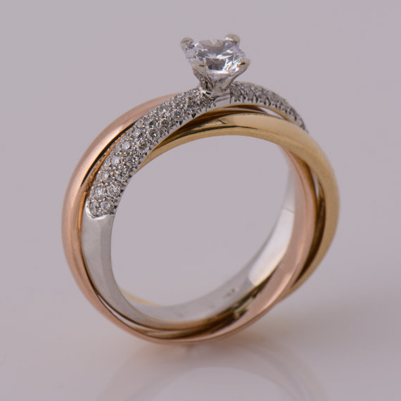 Three Tone metal engagment ring with round diamond center stone