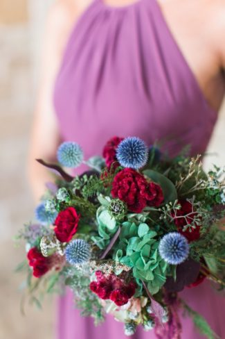 bridesmaid in purple dress with bouquet