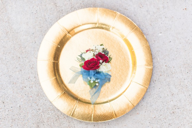 corsage on gold charger