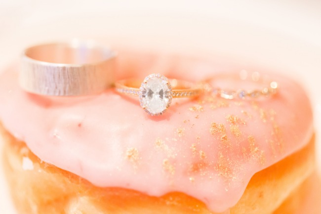 engagement ring on frosted donut