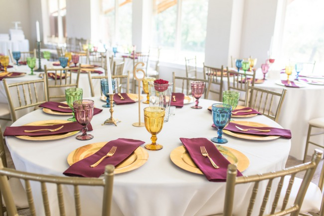 gold and burgundy table setting