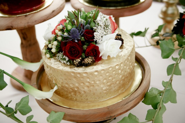gold color cake with florals