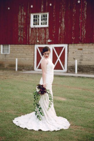model with barn background