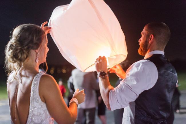 newlyweds light paper lantern