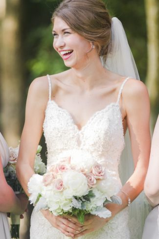 portrait of laughing bride with bouquet