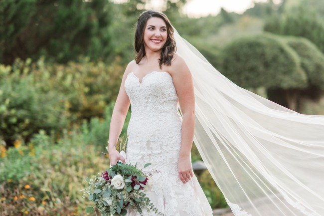 styled bride with blowing veil