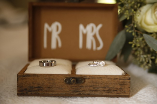 wedding rings on pillow in wood box
