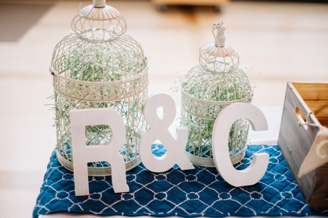 white birdcage with letters