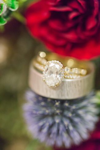 women's engagement ring on blue thistle