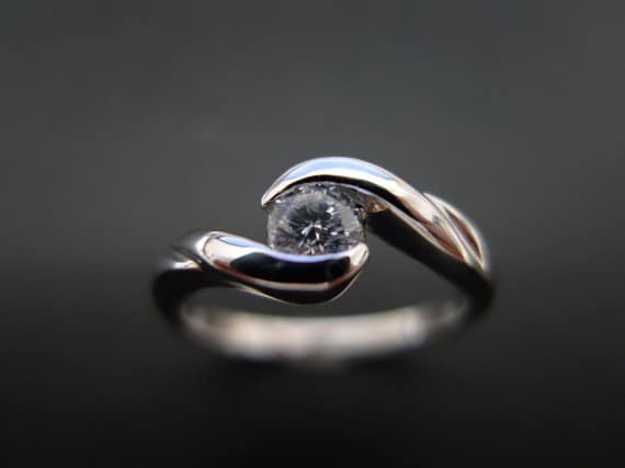 Classic Diamond Engagement Ring with twist