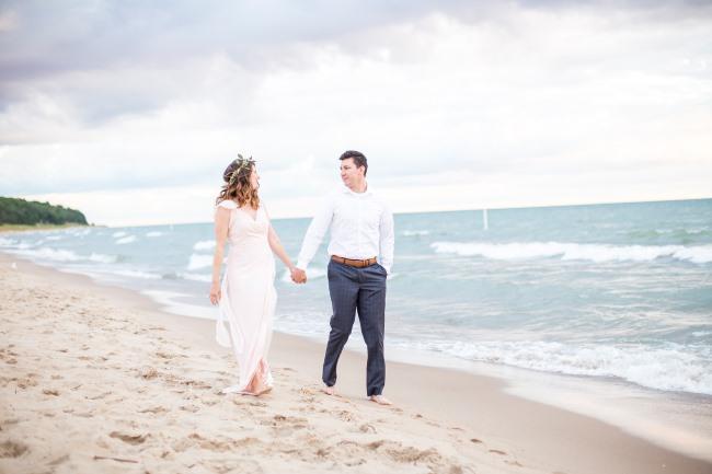 anniversary couple on Oval Beach in Saugatuck