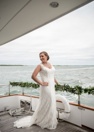 bride at back of yacht railing